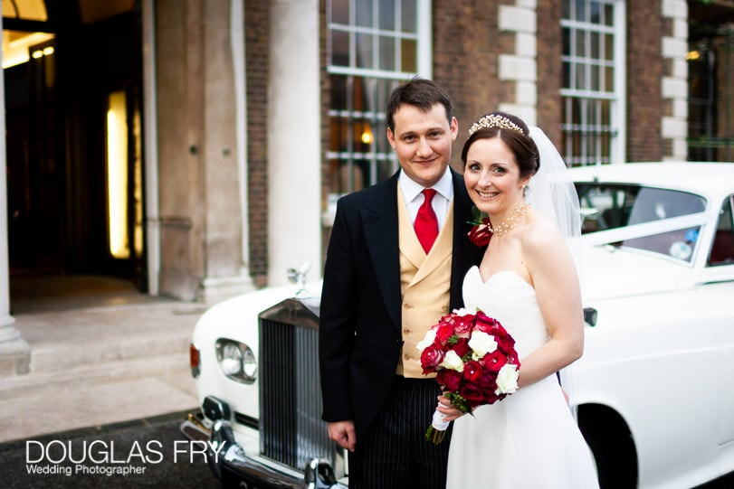 Bride and groom photographed in front of HAC in London