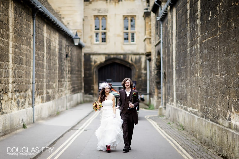 Micro wedding - photography of couple walking through the centre of Oxford