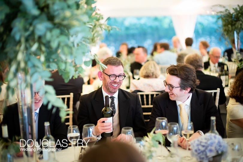guests at country wedding photographed with Leica Noctilux Lens in low light