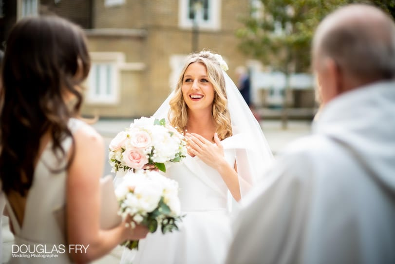 Bride photographed outside Christ Church in Chelsea